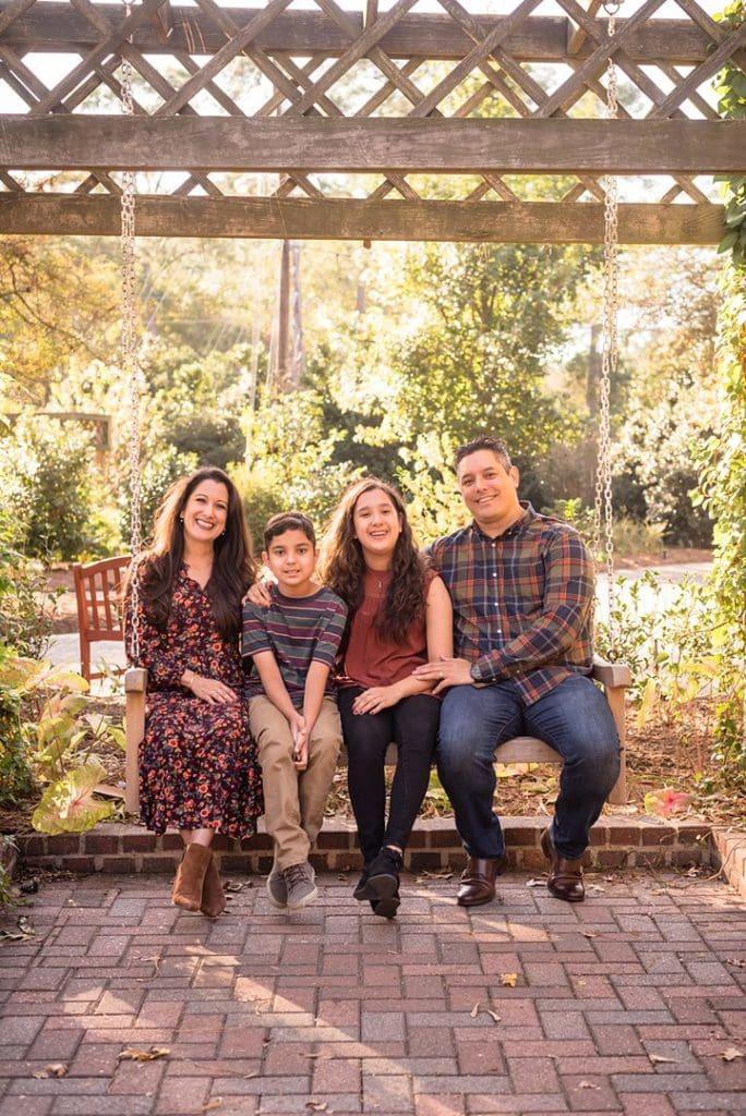 houston special needs photographer shooting family at mercer botanical garden